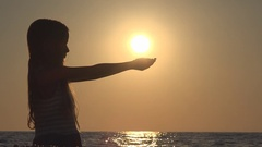 Child Silhouette Playing on Beach, Sunset View of Girl Hand in Sun Rays, Beam Stock Footage