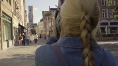 Young Woman Photographs The Belfry Of Bruges, A Medieval Bell Tower In Belgium Stock Footage