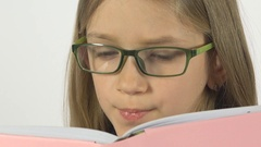 Eyeglasses Child Reading a Book, Portrait Student Girl Learning, White Screen Stock Footage