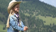 4K Cowherd Child Portrait in Mountains, Shepherd Girl Looking to Cattle, Cows Stock Footage