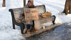 4K.Young  unemployment   man on bench in  winter city park. No job is problem Stock Footage