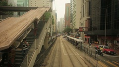 Double deck tram passing through the Causeway Bay district of Hong Kong Island Stock Footage