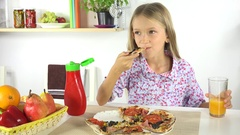 4K Child Eating Pizza, Girl Drinking Oranges Juice in Kitchen, Unhealthy Food Stock Footage
