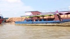 Cambodia. Brightly coloured river taxis - empty Stock Footage