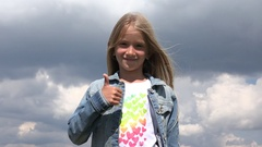 4K Happy Child Showing Thumb Up, Girl Smiling Portrait, Face Outdoor in Park Stock Footage