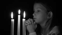 4K Sad Portrait Child Praying by Candles, Girl in Night, Pensive Upset Vintage Stock Footage