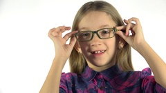 4K Shortsighted Child Testing New Glasses, Eyeglasses Little Girl Face, Portrait Stock Footage