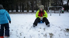 Laughing Girl Enjoying Snow and Winter Outdoors. Restless Woman Wearing Warm Stock Footage