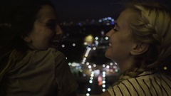 Young Women Enjoy City Lights At Night From Rooftop In Paris, France Stock Footage