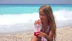4K Child Portrait Drinking Juice on Beach, Thirsty Girl Face View on Seashore Stock Footage