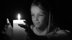 4K Happy Child with Candle, Prayer Girl in Night, Kid Portrait Face Vintage View Stock Footage