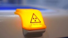 Warning sign about radioactive radiation, bright yellow, on working equipment Stock Footage