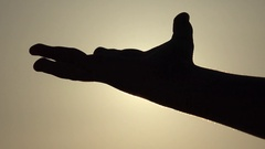 4K Child Hand Catching Playing Sun Rays, Beams in Fingers, Palm Silhouette Stock Footage