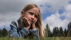 4K Dreaming Child Portrait Outdoor in Park, Smiling Girl Face on Meadow in Grass Stock Footage