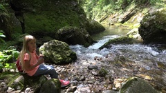 4K Child Drinking River Water, Girl at Camping in Mountains, Kid in Nature Stock Footage