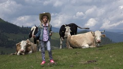 4K Shepherd Child, Cows Grazing on Pasture, Farmer Cowherd Girl with Cattle Stock Footage