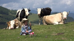 4K Shepherd Child, Cows Grazing on Pasture, Cowherd Girl with Cattle in Mountain Stock Footage