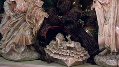 Panning view from baby Jesus through some nativity figurines Stock Footage