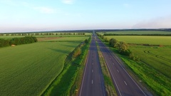 Long straight road middle of rural area Stock Footage
