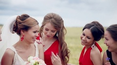 Attractive bride and bridesmaids having fun, laughing. Slow motion Stock Footage