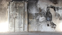 Large steel door in an old factory shop opens by ghost Stock Footage