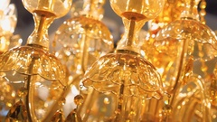 Beautiful golden color crystal chandelier illuminates all around warm amber ligh Stock Footage
