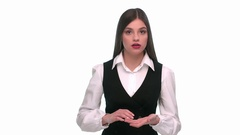Girl in a business suit shows and blames stupidity Stock Footage