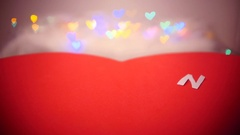 Moving red paper heart with white letters Stock Footage