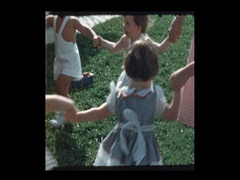 Kids play Ring Around the Rosie Stock Footage