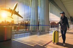 Traveling woman  in airport terminal Kuvituskuvat