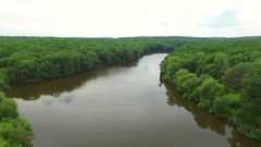 Aerial view the river on green forest plain Stock Footage