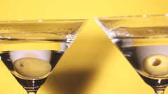 Close up of two martini glasses toasting. Stock Footage