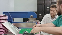 Technicians Using PCB Separator Machine Stock Footage