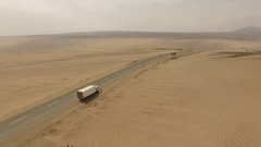 AERIAL: Driving on a highway in desert (Panamericana, Peru, South america) Stock Footage