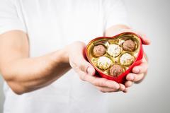 Man Holding Heart-shaped Chocolate Candy Box Stock Photos