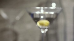 Martini glass with green olive. Stock Footage