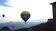 Hot air balloons flying over the old city of Mondovì (Piedmont, Italy) Stock Footage