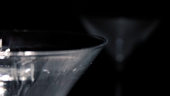 Olive falling in coctail glass in slow motion. Stock Footage