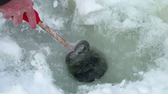 Concept healthy lifestyle. Ice fishing - Fisherman catch perch fish Stock Footage