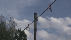 Clothesline with clothespins on blue sky background Stock Footage