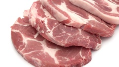Raw pork chop meat on white background Stock Footage