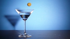 Green olives falling in coctail glass in slow motion. Stock Footage