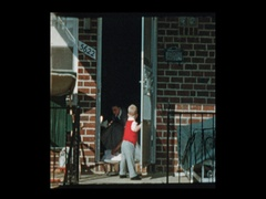 LIttle boy  holds open door for mom as they leave house picks up antique camera Stock Footage