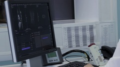 Doctor scans of x-ray images on a computer Stock Footage