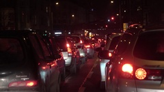 Cars in a row in traffic jam at night Stock Footage