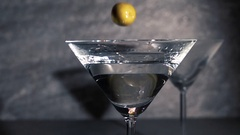 Olives falling in coctail glass in slow motion. Stock Footage