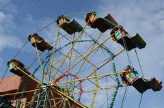 Underside view of a cheap ferris wheel under blue sky Stock Photos