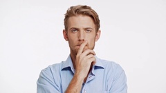 Unapproving Caucasian male with brown beard and blue eyes on white background Stock Footage