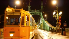 Train on the Liberty Bridge at night in Budapest Stock Footage