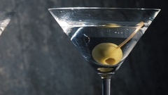 Martini glasses with green olive. Stock Footage